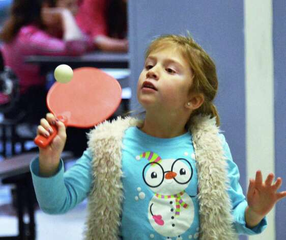 Six-year-old Torre McNeff plays ping pong during Watervliet Civic Center's after school program at Watervliet Elementary School Friday Dec. 7, 2012.  (John Carl D'Annibale / Times Union) Photo: John Carl D'Annibale / 00020348A