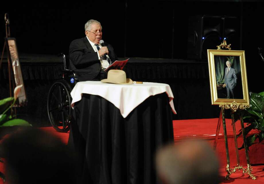 "Carl Parker addresses guests during Jack Brook's ""Celebration of Life"" services at the Montagne Center in Beaumont, Texas, on Sunday, Dec. 9, 2012. Brook's Stetson hat, portrait and one of his cigars can be seen in the photo. The famed congressman died Tuesday night at Baptist Hospital from a sudden illness. (AP Photo/The Enterprise, Guiseppe Barranco) Photo: Guiseppe Barranco, Associated Press / The Beaumont Enterprise"