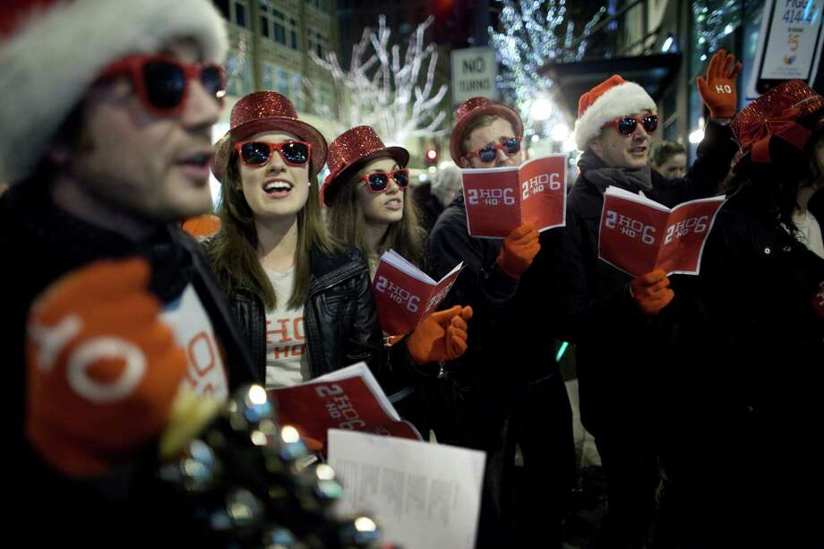 "Members of ""2 Ho Ho 6"" sing during The Great Figgy Pudding Street Corner Caroling Competition on Friday, December 7, 2012. The annual event brought thousands of people downtown to hear groups sing and compete to raise money for the Pike Market Senior Center & Food Bank. Photo: JOSHUA TRUJILLO / SEATTLEPI.COM"