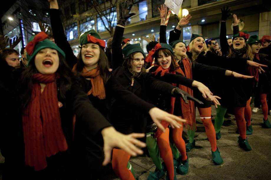 Singers from Pike Pub and Brewery perform during The Great Figgy Pudding Street Corner Caroling Competition on Friday, December 7, 2012. The annual event brought thousands of people downtown to hear groups sing and compete to raise money for the Pike Market Senior Center & Food Bank. Photo: JOSHUA TRUJILLO / SEATTLEPI.COM