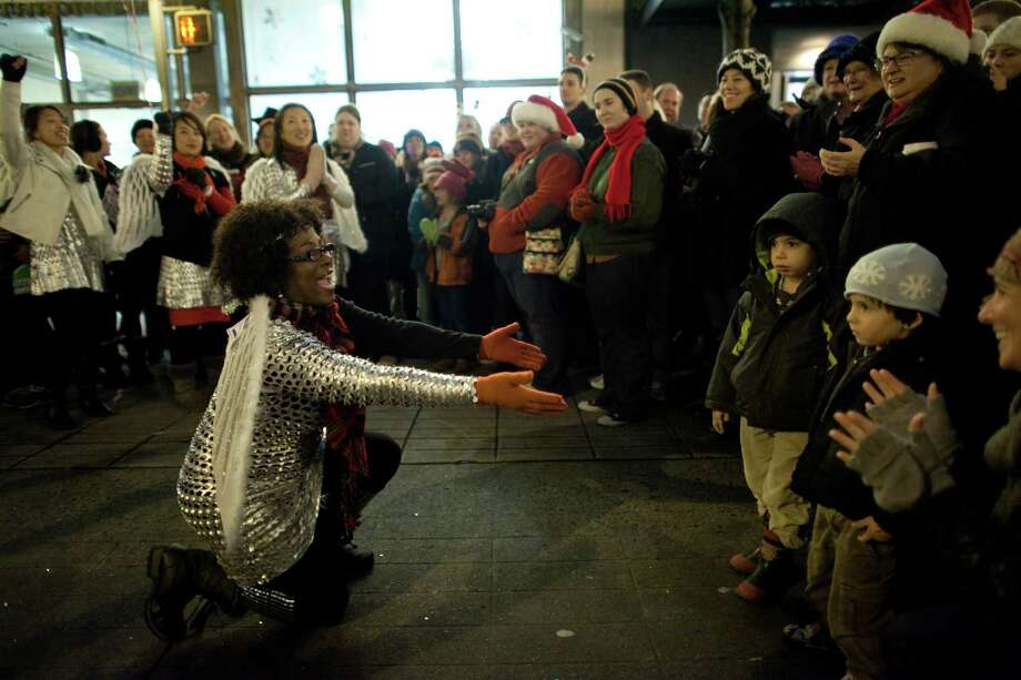 Members of The Seattle Community Church perform during The Great Figgy Pudding Street Corner Caroling Competition on Friday, December 7, 2012. The annual event brought thousands of people downtown to hear groups sing and compete to raise money for the Pike Market Senior Center & Food Bank. Photo: JOSHUA TRUJILLO / SEATTLEPI.COM