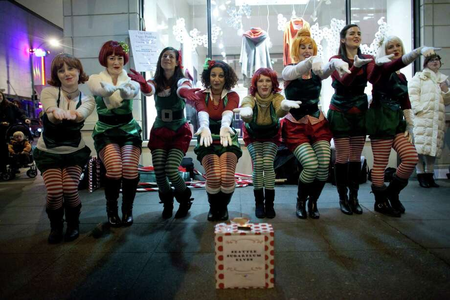 The Seattle Sugar Plum Elves perform during The Great Figgy Pudding Street Corner Caroling Competition on Friday, December 7, 2012. The annual event brought thousands of people downtown to hear groups sing and compete to raise money for the Pike Market Senior Center & Food Bank. Photo: JOSHUA TRUJILLO / SEATTLEPI.COM