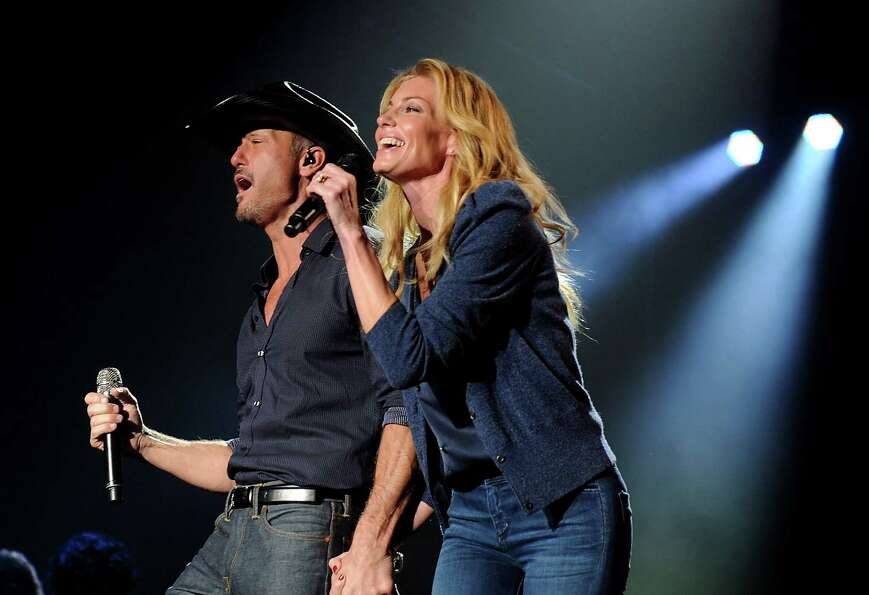 Tim McGraw and Faith Hill perform at the Lanier Christmas Party Sunday Dec. 09, 2012.(Dave Rossman/F