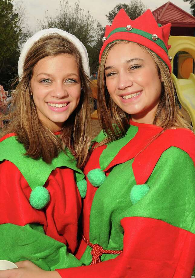 Santa's helpers Mackenzie Rasmussen and Taylor Czernohus at the Lanier Christmas Party Sunday Dec. 09, 2012.(Dave Rossman/For the Chronicle) Photo: Dave Rossman, Freelance / © 2012 Dave Rossman