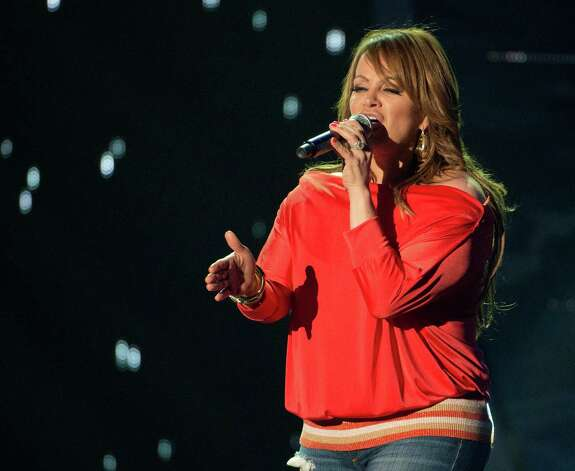 This April 25, 2012 photo released by Telemundo shows Latin singer Jenni Rivera rehearsing for the 2012 Billboard Latin Music Awards,  at the BankUnited Center in Coral Gables, Fla.  The wreckage of a small plane believed to be carrying Mexican-American music superstar Jenni Rivera was found in northern Mexico on Sunday and there are no apparent survivors, authorities said. Photo: Gary I Rothstein, Associated Press / Telemundo