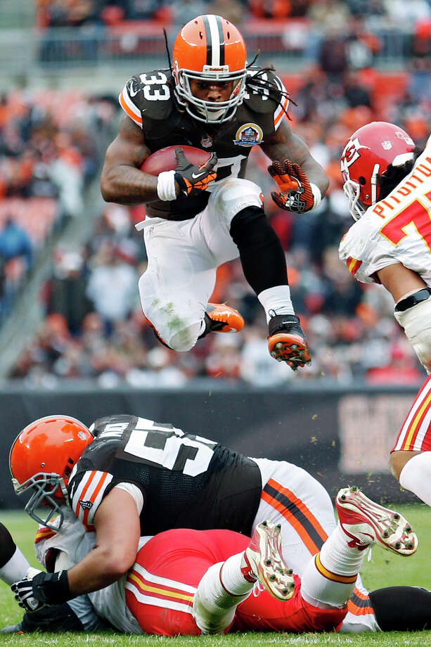 Cleveland Browns running back Trent Richardson (33) leaps over the line during the third quarter of an NFL football game against the Kansas City Chiefs, Sunday, Dec. 9, 2012, in Cleveland. (AP Photo/Rick Osentoski) Photo: Rick Osentoski, Associated Press / FRE17444 AP