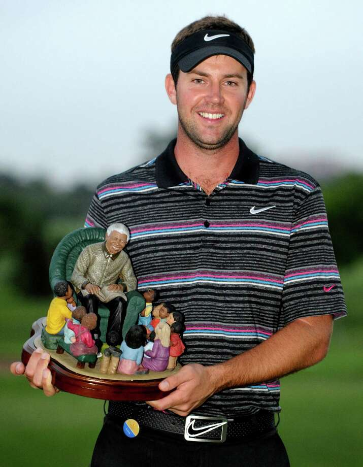 Scotland's Scott Jamieson holds the trophy after winning the inaugural Nelson Mandela Championship Golf tournament in Durban, South Africa, Sunday, Dec. 9, 2012. (AP Photo)