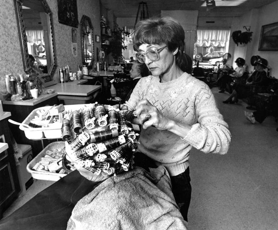 Judy Currytto cuts a customer's hair at Haydee's Coiffures on Hope Street in Springdale on Dec. 10, 1987. Photo: Advocate