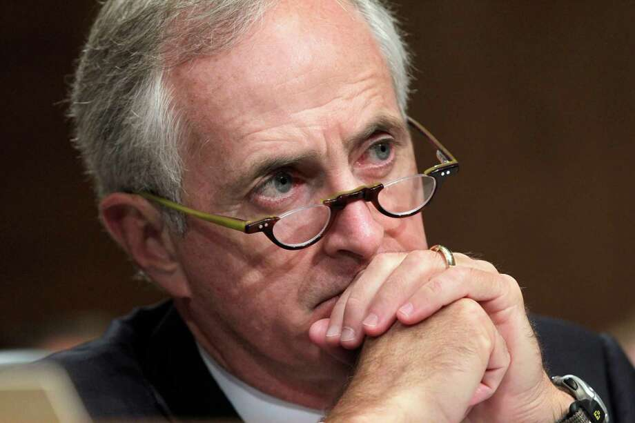 FILE - This Oct. 6, 2011 file photo shows Senate Banking Committee member Sen. Bob Corker, R-Tenn. listening during a hearing on Capitol Hill in Washington. Corker is spending a lot of time lately talking to Democrats. The freshman lawmaker from Tennessee spoke briefly last week with Treasury Secretary Timothy Geithner after he unveiled his 10-year, $4.5 trillion solution to averting the end-of-year, double economic hit of tax hikes and automatic spending cuts. Deficit-cutting maven Erskine Bowles had forwarded Corker's proposal to White House Chief of Staff Jack Lew.  (AP Photo/J. Scott Applewhite) Photo: J. Scott Applewhite