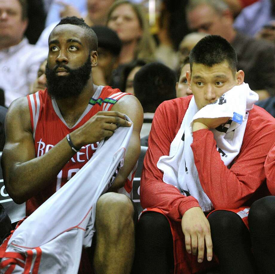 The Rockets never recovered from a slow start Friday, meaning James Harden, left, and Jeremy Lin could only watch helplessly in the fourth quarter. Photo: Billy Calzada, Staff / SAN ANTONIO EXPRESS-NEWS