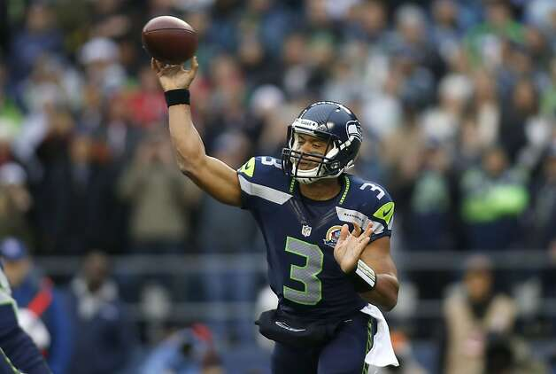 Seattle's Russell Wilson didn't need to do much against hapless Arizona, completing 7 of 13 passes for 148 yards and one touchdown. Photo: John Froschauer, Associated Press