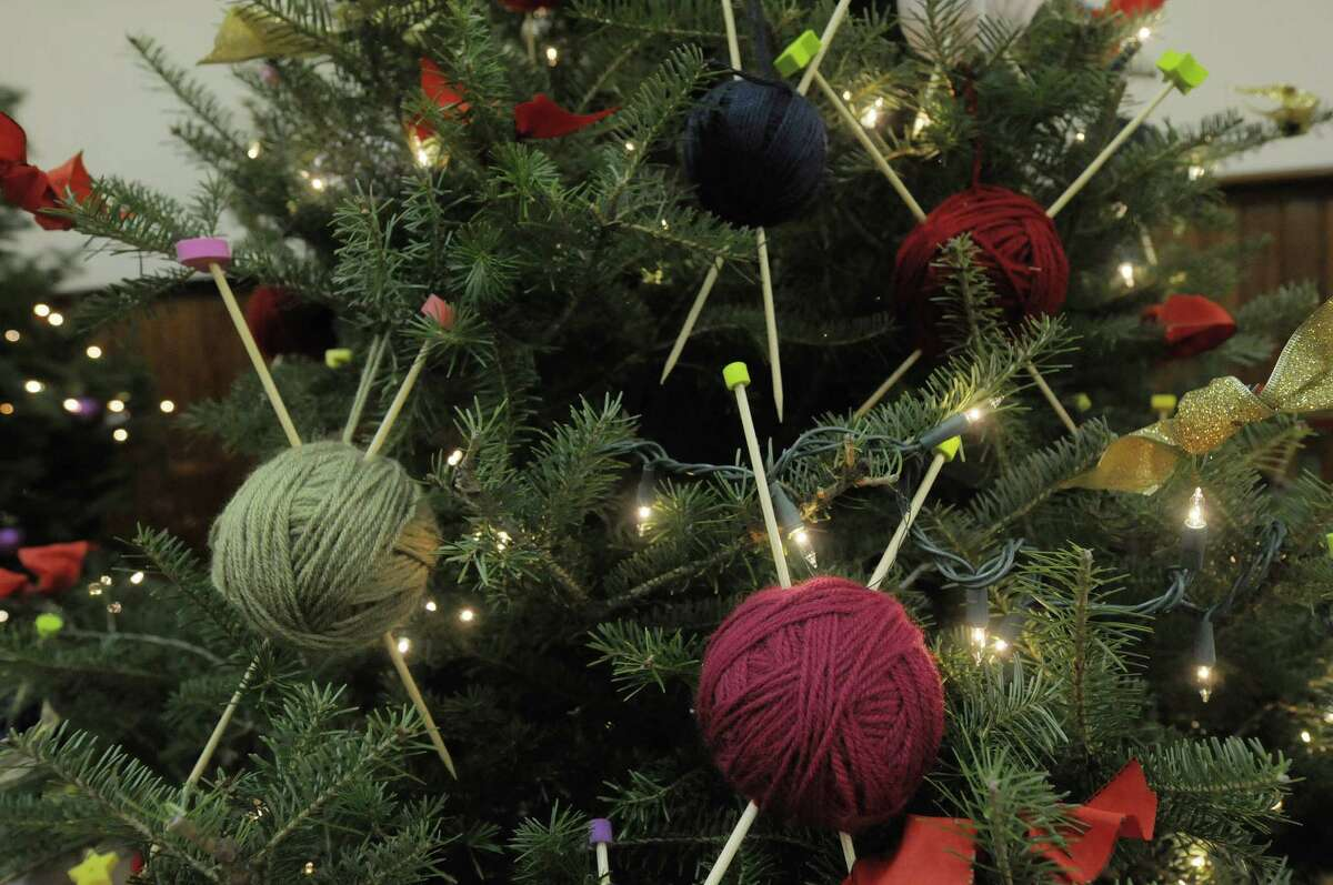 A tree decorated with knitting needles and balls of yarn created by The Spinning Room Yarn Shop is seen on display at the Festival of Trees and Wreath Auction in the Masonic Hall during the Victorian Holidays Celebration on Sunday, Dec. 9, 2012 in Altamont, NY. There was also a tour of six area homes decorated for the holiday. (Paul Buckowski / Times Union)
