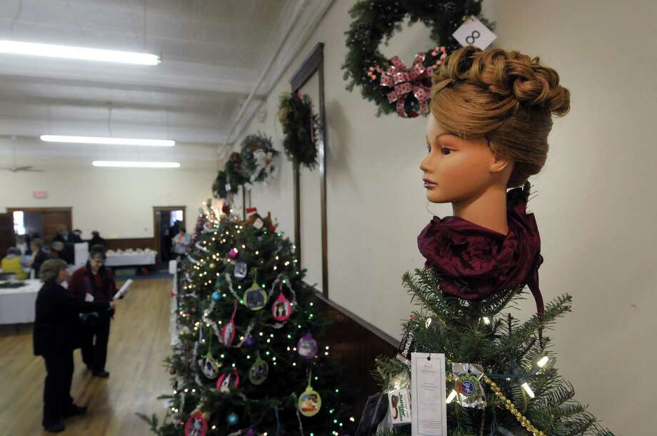 A tree decorated on top with a hairdressing mannequin, created by Re-Nue Spa is seen on display at the Festival of Trees and Wreath Auction in the  Masonic Hall during the Victorian Holidays Celebration on Sunday, Dec. 9, 2012 in Altamont, NY.  There was also a tour of six area homes decorated for the holiday.  (Paul Buckowski / Times Union) Photo: Paul Buckowski