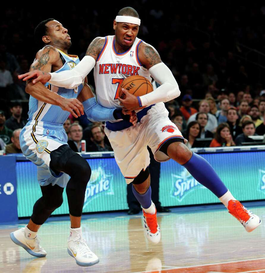 New York Knicks' Carmelo Anthony (7) drives against Denver Nuggets' Andre Iguodala during the first half of an NBA basketball game, Sunday, Dec. 9, 2012, in New York. (AP Photo/Jason DeCrow) Photo: JASON DECROW