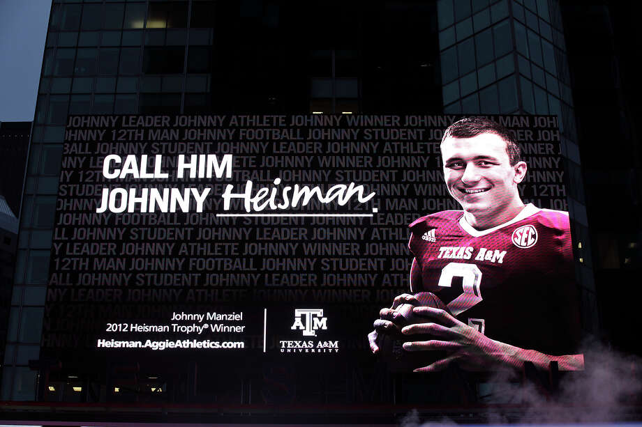 A billboard in Times Square salutes Johnny Manziel's achievement on Sunday. Photo: Edward A. Ornelas, Staff / © 2012 San Antonio Express-News