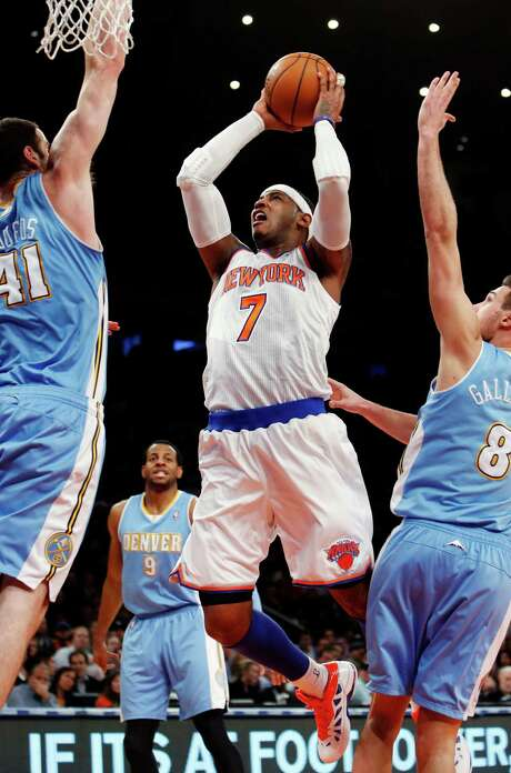 Carmelo Anthony scored 34 points against his former Nuggets teammates. Photo: JASON DECROW, FRE / FR103966 AP