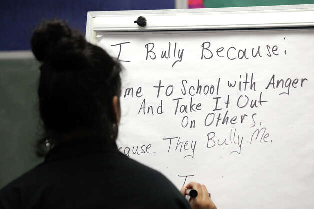 Sierra Luna, of United Communities of San Antonio, writes comments from students during an anti-bullying, anti-bigotry workshop for 5th graders at Candlewood Elementary. Friday, Dec. 7, 2012. Photo: Bob Owen, San Antonio Express-News / © 2012 San Antonio Express-News