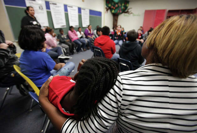 Naderia Hartley, right, Couselor at Candlewood Elementary School, comforts a student as Maudie Magallon, far left, of United Communities of San Antonio conducts an anti-bullying, anti-bigotry workshop for 5th graders at Candlewood Elementary. Friday, Dec. 7, 2012. Photo: Bob Owen, San Antonio Express-News / © 2012 San Antonio Express-News