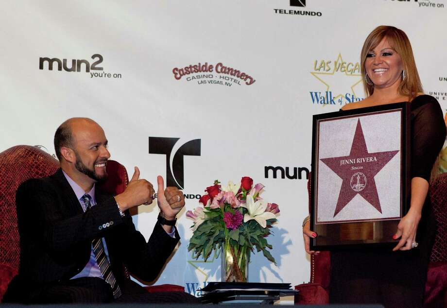 In this July 1, 2011 file photo, singer Jenni Rivera, right, poses with a replica of a star for the Las Vegas Walk of Stars as her husband, former Major League Baseball pitcher Esteban Loaiza, reacts during an official presentation ceremony in Las Vegas. Photo: Julie Jacobson, Associated Press / AP