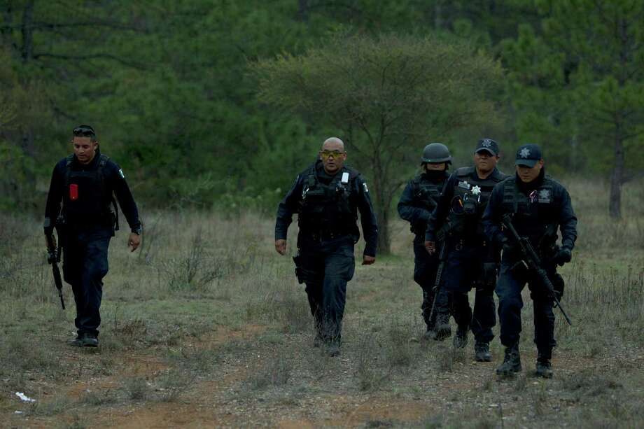 Federal police officers return from the crash site where a plane allegedly carrying U.S-born singer Jenni Rivera crashed near Iturbide, Mexico Sunday Dec. 12, 2012. The wreckage of a small plane believed to be carrying Jenni Rivera, the U.S-born singer whose soulful voice and unfettered discussion of a series of personal travails made her a Mexican-American superstar, was found in northern Mexico on Sunday. Authorities said there were no survivors. Photo: Hans-Maximo Musielik, Associated Press / AP