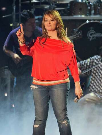 This April 25, 2012 photo released by Telemundo shows Latin singer Jenni Rivera rehearsing for the 2012 Billboard Latin Music Awards,  at the BankUnited Center in Coral Gables, Fla. Photo: Gary I Rothstein, Associated Press / Telemundo
