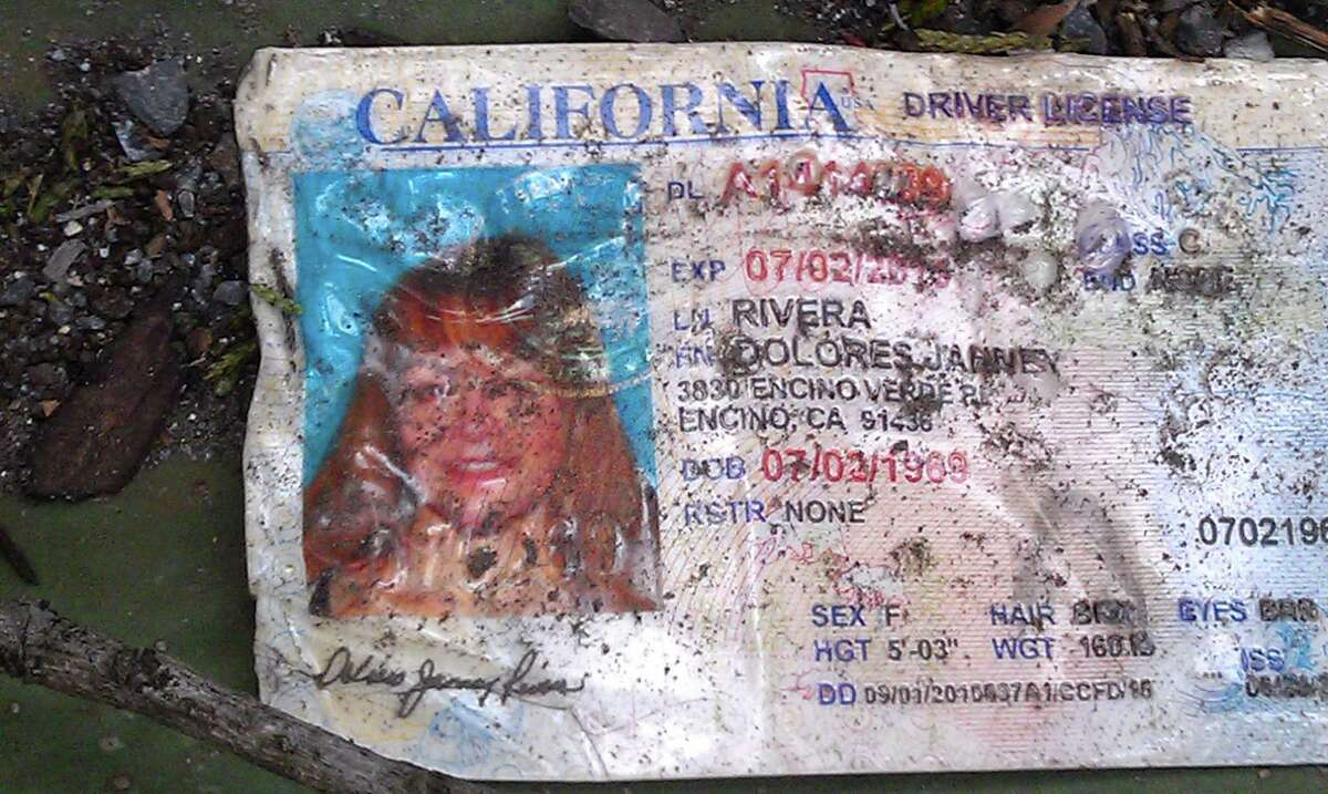 Jenni Rivera's driving license is seen of the ground at the crash site where a plane allegedly carrying Rivera crashed near Iturbide, Mexico Sunday Dec. 12, 2012. The wreckage of a the small plane believed to be carrying Jenni Rivera, the U.S-born singer whose soulful voice and unfettered discussion of a series of personal travails made her a Mexican-American superstar, was found in northern Mexico on Sunday. Authorities said there were no survivors.