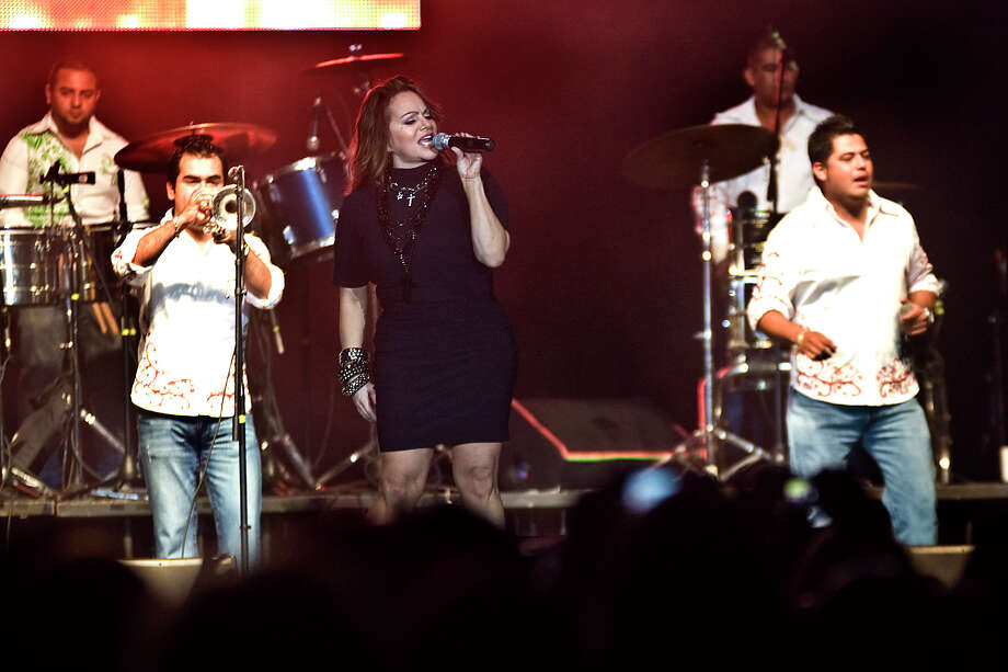 Regional artist Jenni Rivera, center, performs at the Laredo Energy Arena on Friday, July 16, 2010, where she connected very well with the women. Photo: Ricardo Segovia, Laredo Morning Times / LAREDO MORNING TIMES