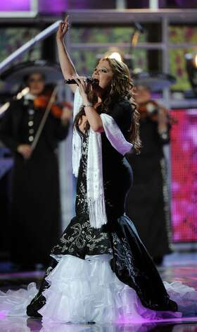 Singer Jenni Rivera performs onstage during the 9th Annual Latin Grammy Awards held on November 13, 2008 in Houston, Texas. Photo: Gabriel Bouys, AFP/Getty Images / AFP