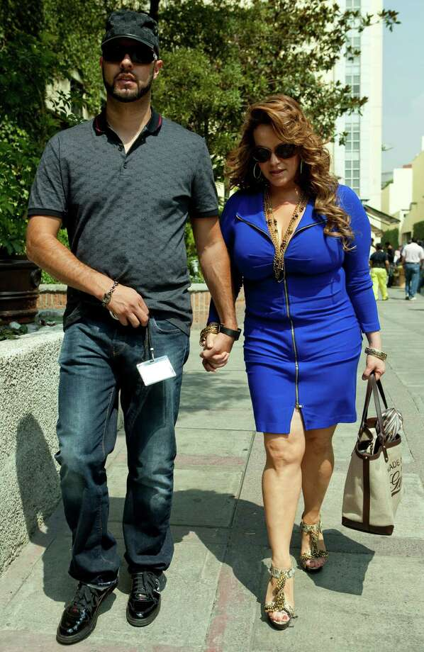 File picture taken on June 14, 2011, of Mexican-American singer Jenni Rivera (R), walking with her then boyfriend, baseball player Esteba Loaiza. Rivera died in a plane crash on December 9, 2012 close to Iturbide, Nuevo Leon state, Mexico. The wreckage of a plane carrying star Mexican-American singer Jenni Rivera has been found in northern Mexico and there were no survivors, officials said. The Lear Jet was flying from south from Monterrey to Toluca, in the center of the country and was carrying six other people besides the singer, said Antonio Gonzalez, mayor of the town of Iturbide, near the crash site. Photo: AFP/Getty Images / AFP