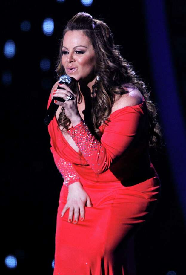 In this April 26, 2012, file photo, singing superstar Jenni Rivera performs during the Latin Billboard Awards in Coral Gables, Fla. Authorities in Mexico say the wreckage of a small plane believed to be carrying Rivera has been found on Sunday, Dec. 9, 2012, and there are no apparent survivors. Photo: Lynne Sladky, Associated Press / AP