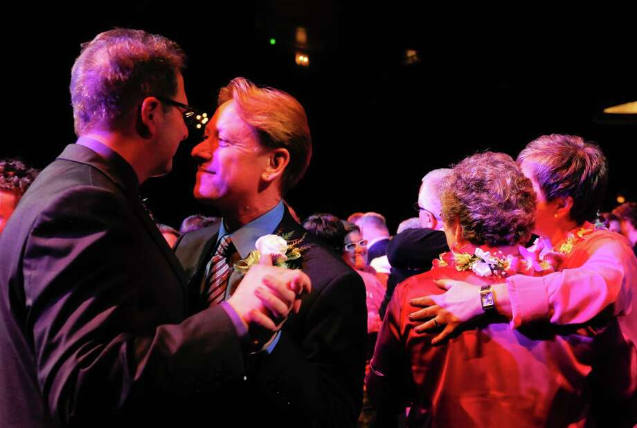 Couples have their first dance during Love Wins: A Wedding Reception For All at the Paramount. Photo: LNDSEY WASSON / SEATTLEPI.COM