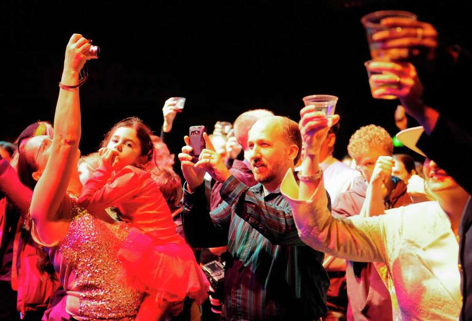 Attendees raise their cups in an official reception toast led by Mayor Mike McGinn. Photo: LNDSEY WASSON / SEATTLEPI.COM