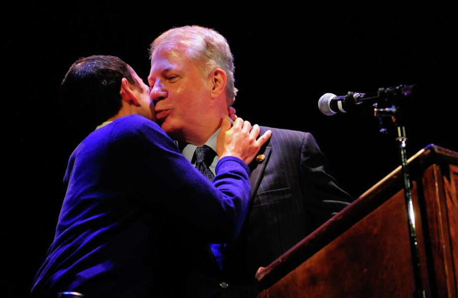 Senator Ed Murray, right, gives his partner, Michael Shiosaki, a kiss as he speaks to the crowd during Love Wins: A Wedding Reception For All at the Paramount. Photo: LNDSEY WASSON / SEATTLEPI.COM
