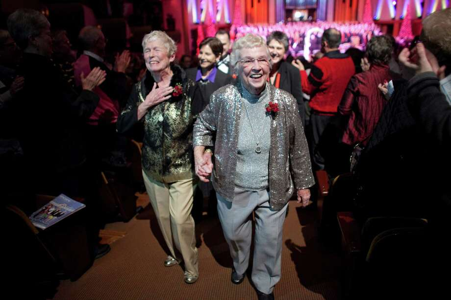 Jane Lightly, 77, and her wife Pete-e Petersen, 85, walk down the aisle after their wedding during a performance of the Seattle Men's Chorus on Sunday, December 9, 2012 at Benaroya Hall in Seattle. Lightly and Petersen have been a couple for 35 years. Sunday was the first day same-sex couple in Washington State could become legally married —something they have waited decades for.  Photo: JOSHUA TRUJILLO / SEATTLEPI.COM