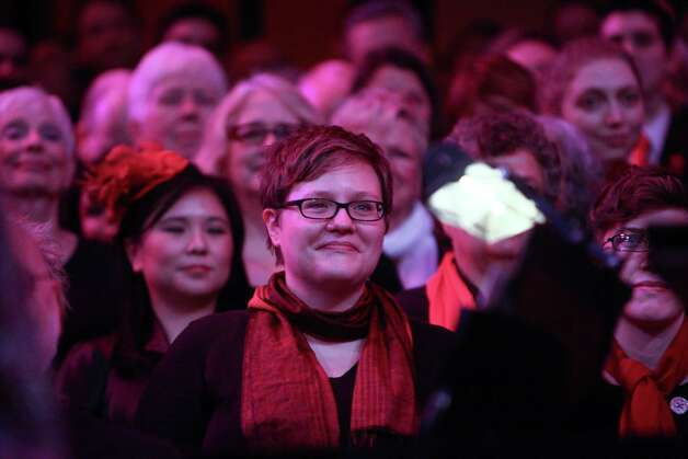 A woman watches the wedding of Jane Lightly and Pete-e Petersen during a performance of the Seattle Men's Chorus on Sunday, December 9, 2012 at Benaroya Hall in Seattle. Sunday was the first day same-sex couple in Washington State could become legally married. Photo: JOSHUA TRUJILLO / SEATTLEPI.COM