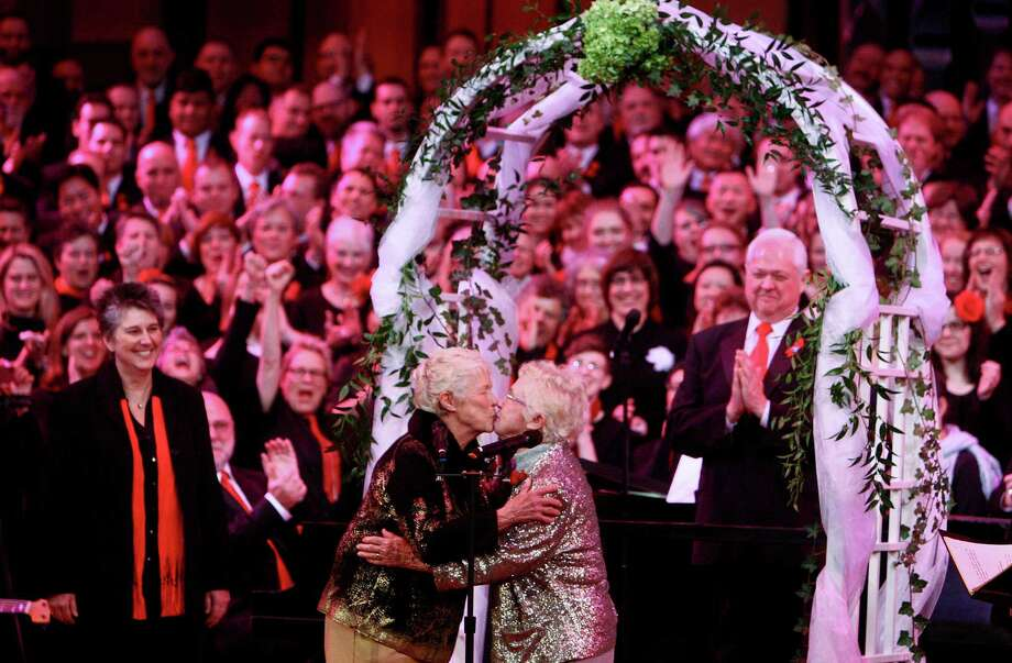 Jane Lightly, 77, and her wife Pete-e Petersen, 85, kiss after they exchanged vows during a performance of the Seattle Men's Chorus at Benaroya Hall in Seattle. Photo: JOSHUA TRUJILLO / SEATTLEPI.COM