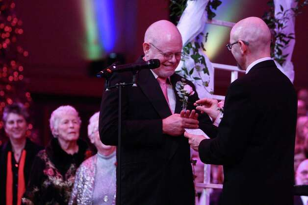 Donald Jenny, left, and Neil Hoyt exchange vows during a performance of the Seattle Men's Chorus on Sunday, December 9, 2012 at Benaroya Hall in Seattle. Sunday was the first day same-sex couple in Washington State could become legally married. Photo: JOSHUA TRUJILLO / SEATTLEPI.COM