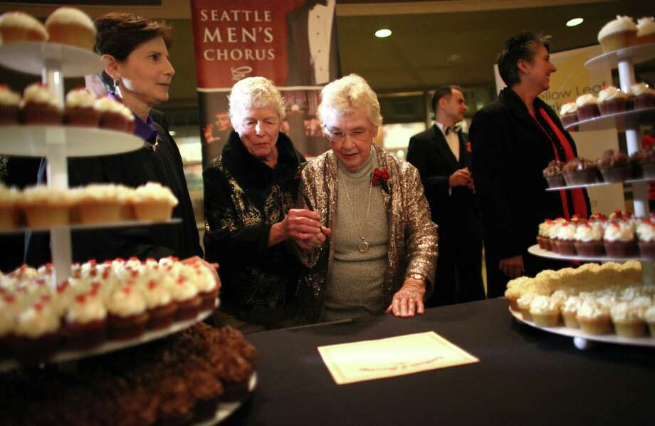 Jane Lightly and her wife Pete-e Petersen sign their marriage certificate during a performance of the Seattle Men's Chorus. They have been together for 35 years. Photo: JOSHUA TRUJILLO / SEATTLEPI.COM