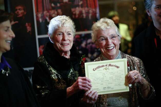Jane Lightly and her wife Pete-e Petersen hold up their marriage certificate during a performance of the Seattle Men's Chorus on Sunday, December 9, 2012 at Benaroya Hall in Seattle. Sunday was the first day same-sex couple in Washington State could become legally married. Photo: JOSHUA TRUJILLO / SEATTLEPI.COM