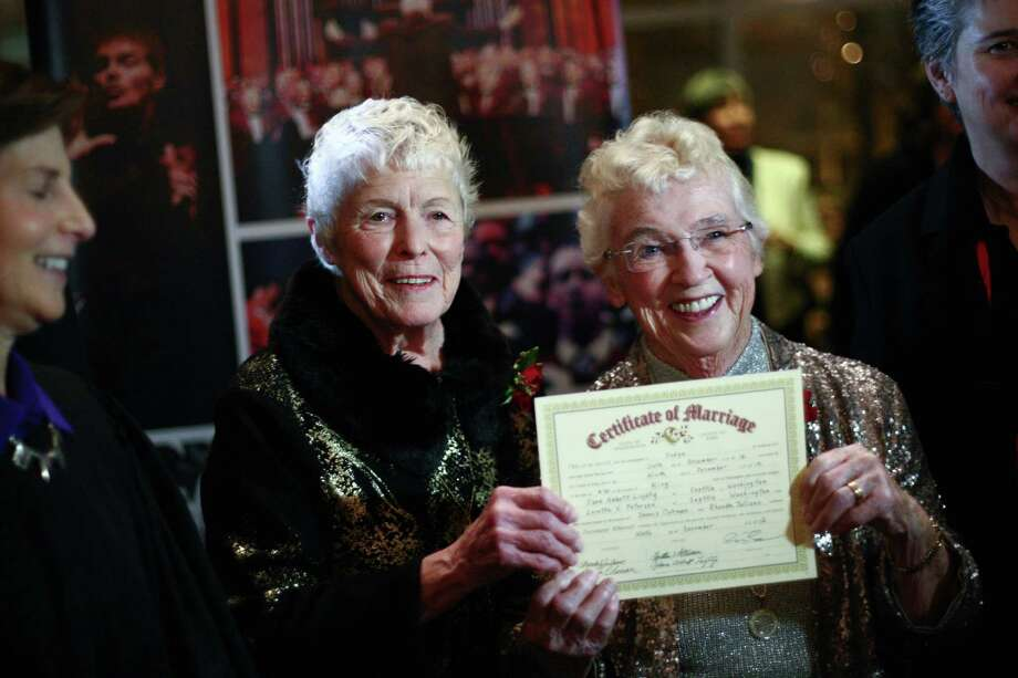 Jane Lightly and her wife Pete-e Petersen hold up their marriage certificate during a performance of the Seattle Men's Chorus on Sunday, December 9, 2012 at Benaroya Hall in Seattle. They have been together for 35 years. Photo: JOSHUA TRUJILLO / SEATTLEPI.COM