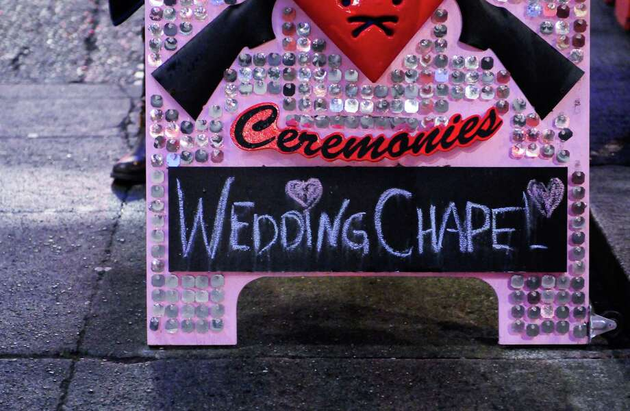 The sign for Shotgun Ceremonies in Pioneer Square is shown on Sunday. Photo: LINDSEY WASSON / SEATTLEPI.COM