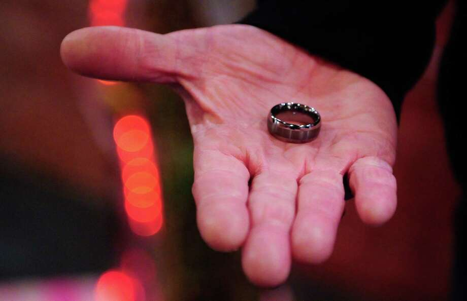 Andrew Robinson holds his ring as he marries his husband Andrew Robinson at Shotgun Ceremonies in Pioneer Square. Photo: LINDSEY WASSON / SEATTLEPI.COM