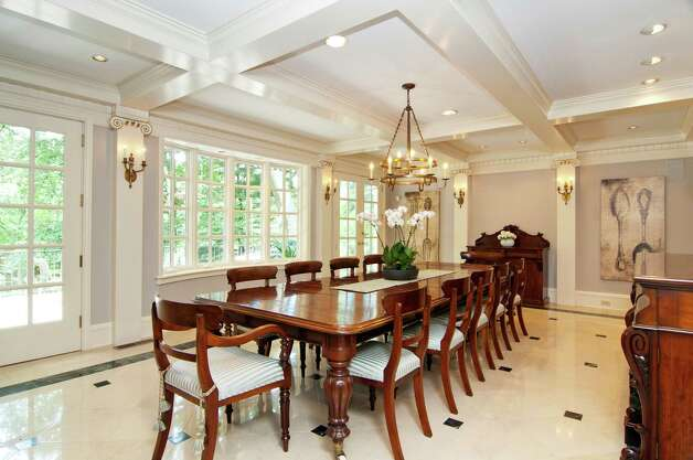 The banquet-sized formal dining room has a coffered ceiling, marble floor, deep dentil molding and two sets of French doors that open to a terrace overlooking the waterfalls. Photo: Dennis M. Carbo Photography, Contributed Photo/Dennis M. Carb / Dennis M. Carbo