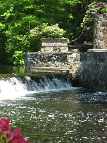The property's waterfalls and exterior stonework provide a beautiful, elegant setting to take in the outdoors. Photo: Contributed Photo