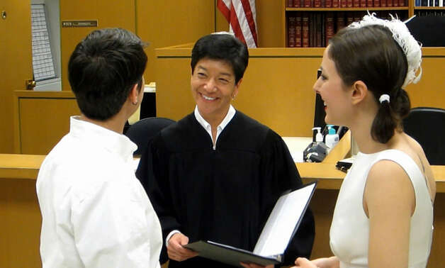 King County Superior Court Judge Mary Yu married Stephanie Lyon and Margaret Ryan on Dec. 9, 2012, the first day a same-sex ceremony could be performed in Washington State. The couple met in 2005 when Ryan rescued Lyon from her burning apartment building. Photo: Casey McNerthney/seattlepi.com