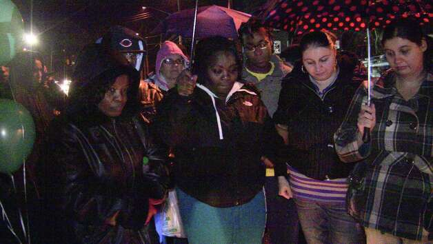 Family and friends gathered Sunday night, Dec. 9, 2012 to mourn the loss of Jayden Szabo, a 4-year-old boy killed after he was struck by a pickup truck on Boston Avenue in Bridgeport, Conn. along with his uncle and grandfather, who survived the accident. Photo contributed by Steve Krauchick, DoingItLocal.com. Photo: Contributed Photo