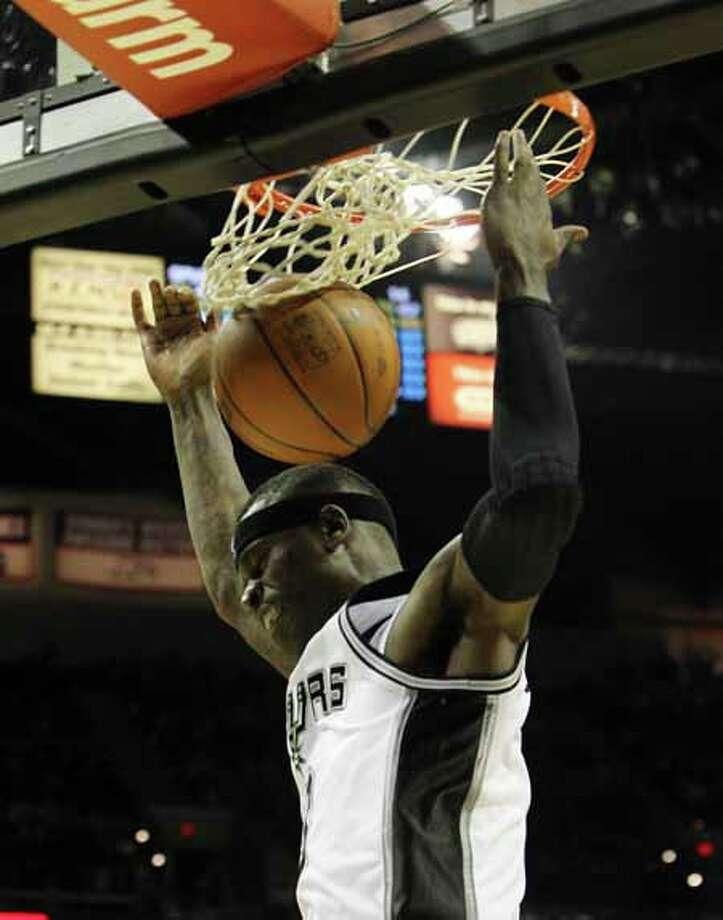 Spurs' Stephen Jackson (03) dunks against the Minnesota Timberwolves at the AT&T Center on Wednesday, Mar. 21, 2012. Kin Man Hui/Express-News. Photo: KIN MAN HUI, San Antonio Express-News / ©2012 San Antonio Express-News