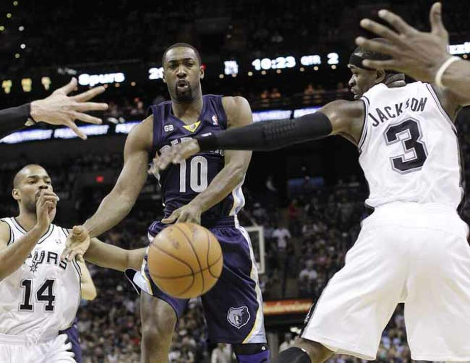 Memphis Grizzlies' Gilbert Arenas (10) is defended by San Antonio Spurs' Gary Neal, left, and Stephen Jackson (3) during the second quarter of an NBA basketball game on Thursday, April 12, 2012, in San Antonio. (AP Photo/Eric Gay) Photo: AP