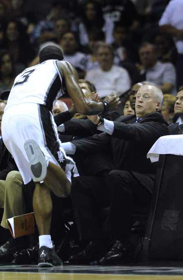 Stephen Jackson of the San Antonio Spurs (3) runs out of bounds toward head trainer Will Sevening during NBA action at the AT&T Center on Saturday, April 14, 2012. Billy Calzada / San Antonio Express-News Photo: BILLY CALZADA, San Antonio Express-News / SAN ANTONIO EXPRESS-NEWS