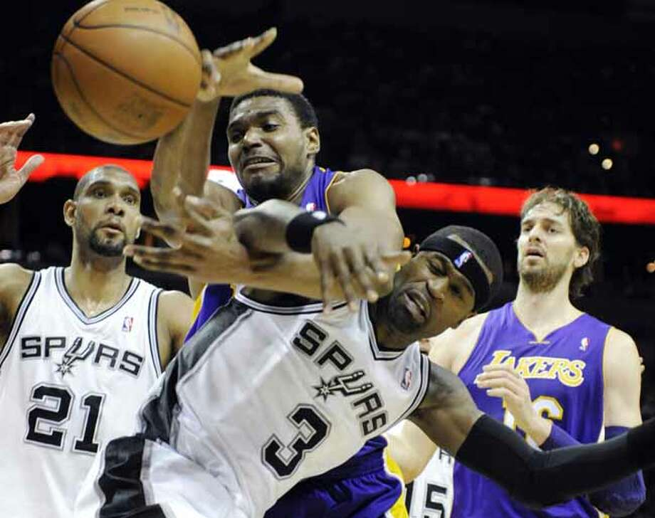 Los Angeles Lakers center Andrew Bynum, top center, and San Antonio Spurs forward Stephen Jackson fight for a loose ball as Spurs forward Tim Duncan, left, and Lakers forward Pau Gasol, right, of Spain, close in during the first half of an NBA basketball game on Friday, April 20, 2012, in San Antonio. (AP Photo/Bahram Mark Sobhani) Photo: AP